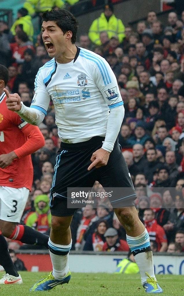 Liverpool-2011-12-adidas-third-kit-Luis-Suarez.jpg