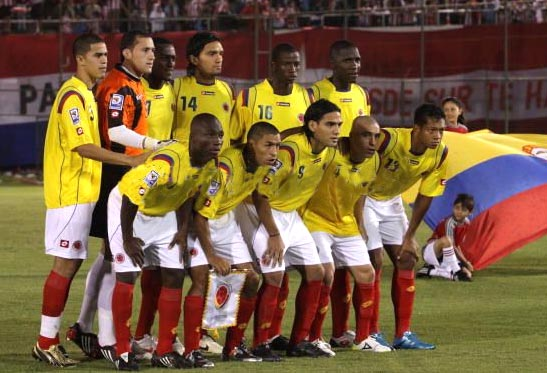 Colombia-09-10-lotto-home-kit-yellow-white-red-pose.JPG