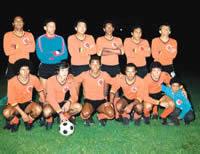 Colombia-75-79-unknown-home-kit-orange-black-orange-line up.jpg