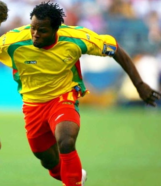 Grenada-09-Plus-One-home-kit-yellow-red-red.jpg