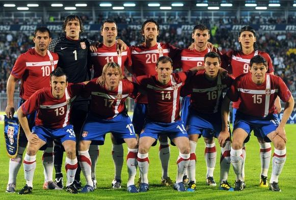 Serbia-10-11-NIKE-home-kit-red-blue-white-pose.JPG