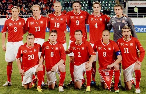 Switzerland-10-11-PUMA-home-kit-red-white-red-pose.JPG