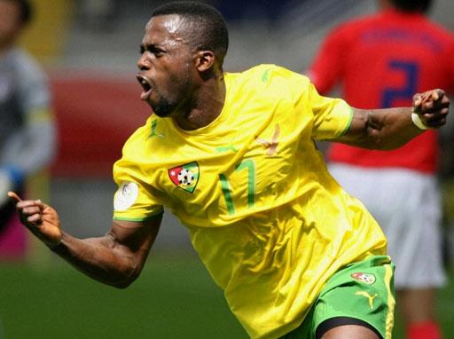 Togo-06-07-PUMA-uniform-yellow-green-white-logo.JPG