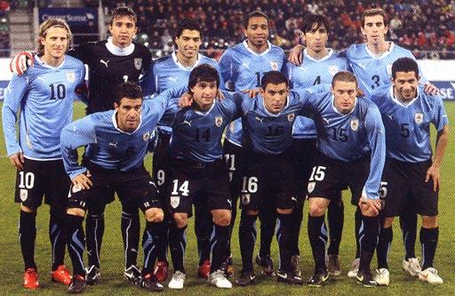Uruguay-10-11-PUMA-kit-light blue-black-black-pose.JPG